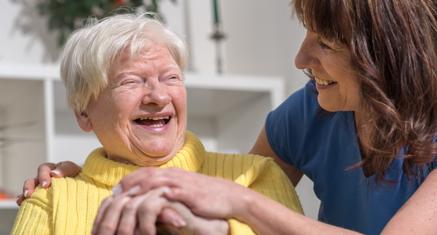 Image shows carer and elderly woman